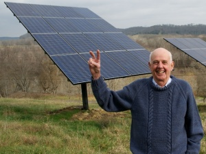 Wendell Berry stands before the solar panels on his farm in Henry County, KY. Photo by Guy Mendes